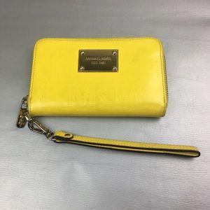 Michael Kors yellow zip around wristlet/ wallet